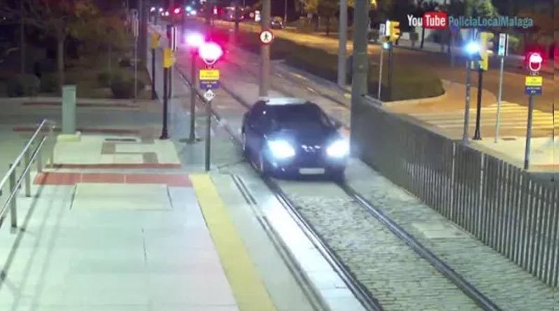 Drunk woman driving a car on a railway track